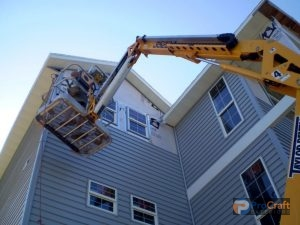 Construction Crew Installing Siding