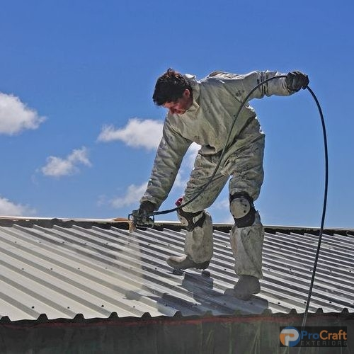 A Roofer Uses an Airless Roof Spray Coating on a Metal Roof